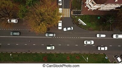 Aerial view of the vehicular intersection, traffic with cars on the road