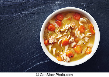 top down photo of chicken noodle soup with copy space on...
