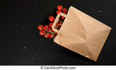Top down view, brown paper shopping bag with cherry tomatoes...