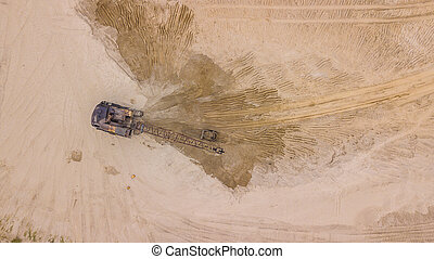 Top down view of digger working, for costruction site.