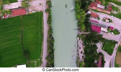 Top Down view of Fast Moving River with Rapids Surrounded by Pine Forest. Shot in Antalya