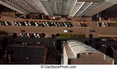 Top down view of fly between cityscapes in downtown with...