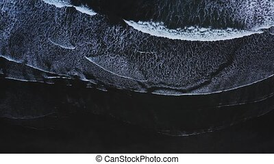 Top down view of giant ocean waves crashing and foaming