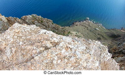 Top down view of high cliff. Rocky coast