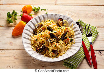 Top down view of pasta recipe with spaghetti and steamed sea...