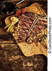 Top down view of sliced t-bone steak
