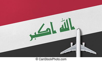 Top-down view of the airplane on the flag of Iraq. Travel...