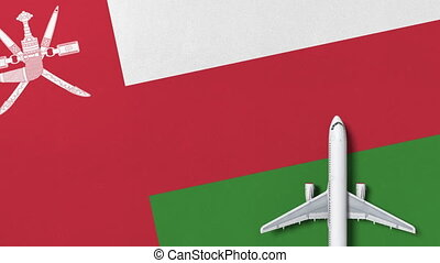 Top-down view of the airplane on the flag of Oman. Tourism...