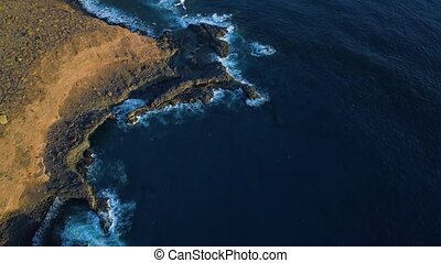 Top down view of waves and clifs - top down view of waves...