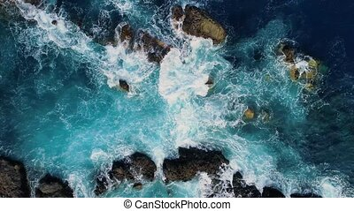 Top down view of waves and clifs