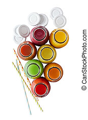 Top down view on multiple jars of nutritious fruit juice and colorful straws over plain white background