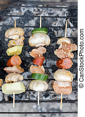 Top flat lay view of meat and vegetables kebabs on the grill