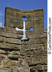 top of a castle wall with single arrow loop