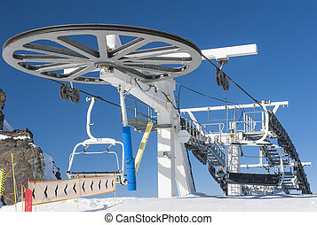 Top of a chairlift in ski resort - Top of an alpine ...