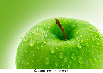 Top of a crisp green apple with water droplets