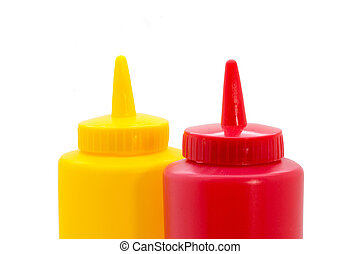 Top of a ketchup and mustard bottle closeup