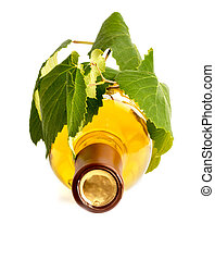 Top of a white wine bottle with grape leaves
