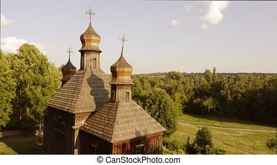 Top of an old orthodox church with crosses. View from a drone raising up.