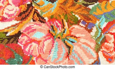 Top of bright embroidery with flowers, close up - The top of...