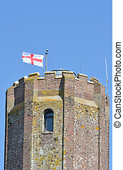 Top of castle tower with george cross flag