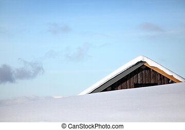 Top of chalet covered in snow
