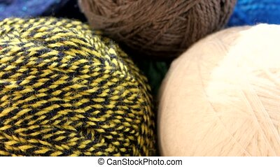 Top of different yarn balls with spokes, rotation, close up...