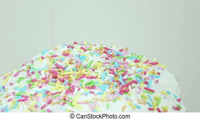 Top of Easter cake - Adding sprinkles on the top of the...