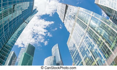 Top of Moscow-City buildings with sky with clouds above....