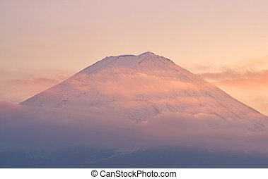 Top of Mountain Fuji with clouds in sunset