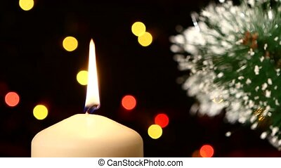 Top of one big white candles with christmas decorations and tree on black, bokeh, light, garland