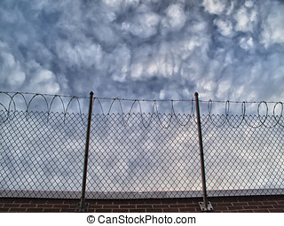 Top of prison walls - Top of brick prison wall has chain...