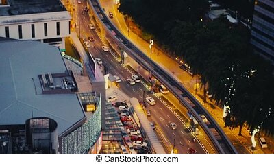 Top of view above crossroads in the city in the evening,...