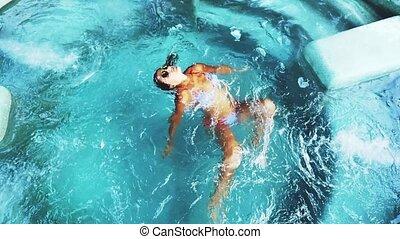 Top of view of beautiful tan young woman in bikini and...