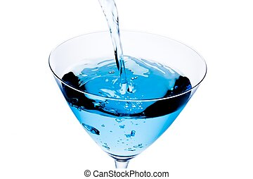 top of view of filling a glass with blue cocktail tilted and bubbles