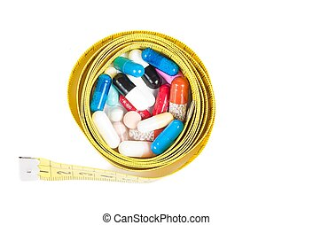 top of view of medical blue pills in front of measure tape, concept for diet