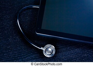 top of view of medical stethoscope near modern digital tablet pc in laboratory on wood table