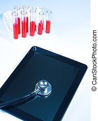 top of view of medical stethoscope on modern digital tablet pc in laboratory