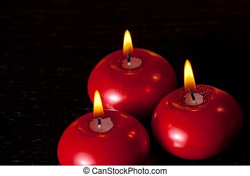 top of view of red christmas candles on black wood table background