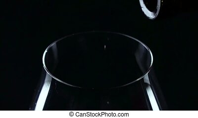 Top of view of red wine in the glass, black, closeup, slowmotion