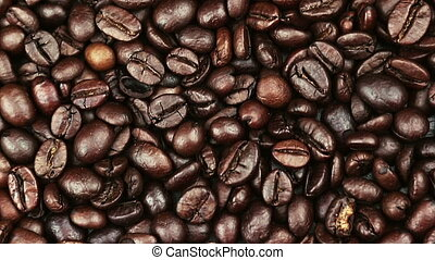top of view of texture of roasted coffee beans with dolly camera movement