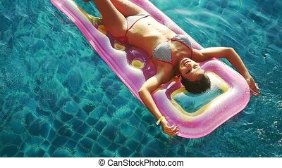 Top of view of young attractive smiles woman enjoying summer...