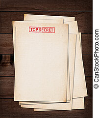 top secret files. - top secret files on wooden table.