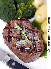 A grilled top sirloin steak .. medium with broccoli and fresh baby potatoes