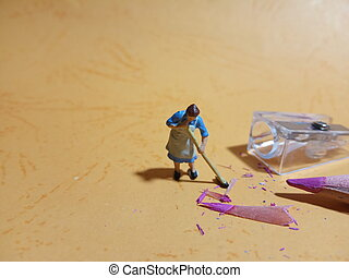 Top View 1 woman cleaning trash from pencil sharpener with negative space