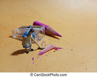 1 woman cleaning trash from pencil sharpener with negative space