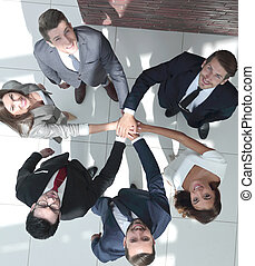top view. a group of business people standing together and looking at the camera
