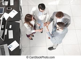 top view. a successful business team celebrates success.