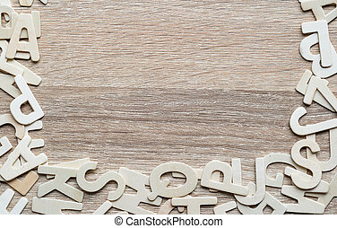 Top view ABC alphabet on wood background