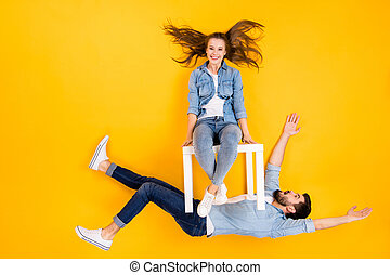 Top view above high angle flat lay flatlay lie view concept of her she his he nice partners girl sitting on stool guy's chest psychology isolated on bright vivid shine vibrant yellow color background