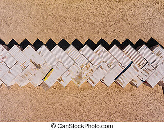 Top view aerial photo of freight containers in rows on beach. Cargo container